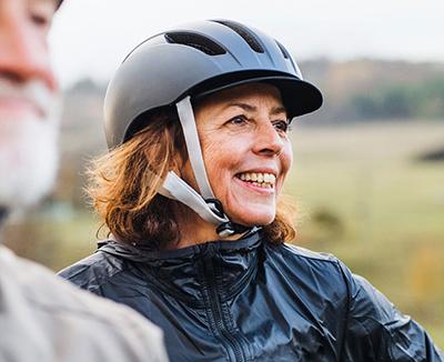 woman cyclist wearing helmet