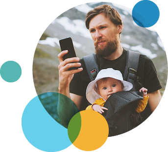 man with baby checking smartphone